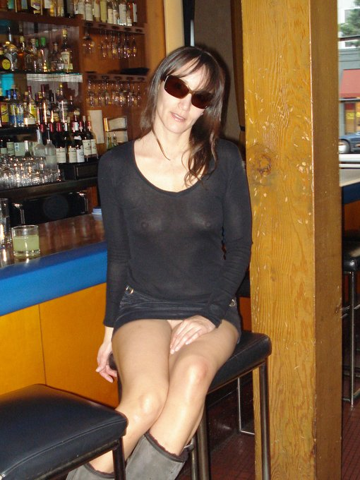 Hot Lady in Seethrough Clothes Flashing Pussy in Public Bar