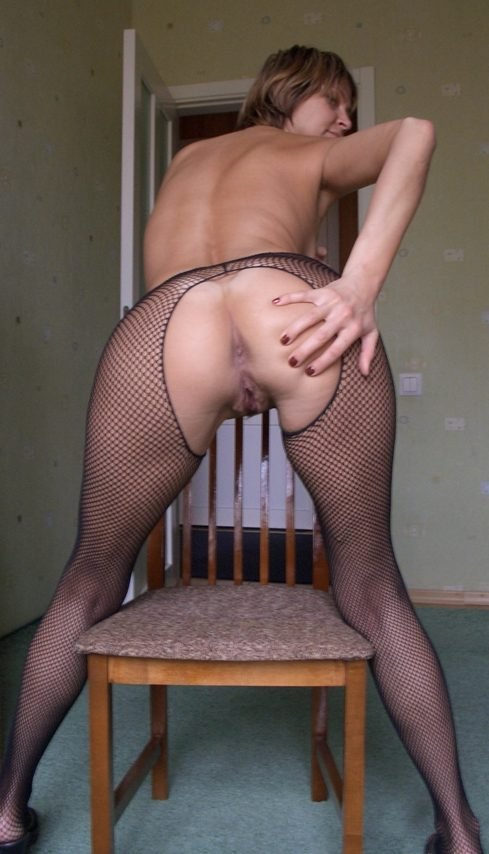 Blonde milf squatting