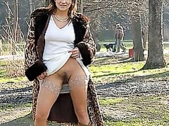 Sexy Woman Flashes Her Hairy Pussy in Public Park