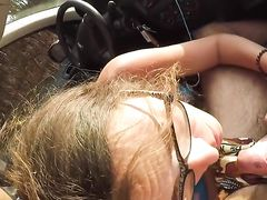 French wife sucking cock in car while he is driving the car
