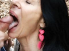 Mature sexy woman filmed swallowing cock and sperm of young man outdoor